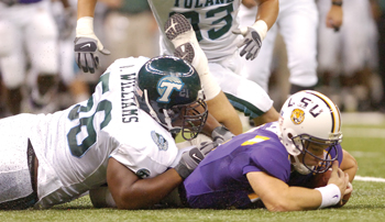 Tulane's Avery Williams lies atop LSU quarterback Matt Flynn after Flynn fumbled in the first half of Saturday's game.